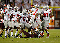 Ohio State Buckeyes linebacker Darron Lee (43) celebrates a tackle for a loss on Virginia Tech Hokies running back Greg Stroman (3) during the second quarter of the NCAA football game at Lane Stadium in Blacksburg, Virginia on Sept. 7, 2015. (Adam Cairns / The Columbus Dispatch)