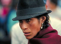 portrait of an attractive Ecuadorian Indian woman, wearing the traditional black, fedora-style hat, on the streets of Quito. women, clothing. Quito, Ecuador.