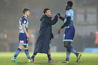 Aaron Pierre of Wycombe Wanderers (right) congratulates Scott Kashket of Wycombe Wanderers (2nd right) on his winning goal after the Sky Bet League 2 match between Wycombe Wanderers and Leyton Orient at Adams Park, High Wycombe, England on 17 December 2016. Photo by David Horn / PRiME Media Images.