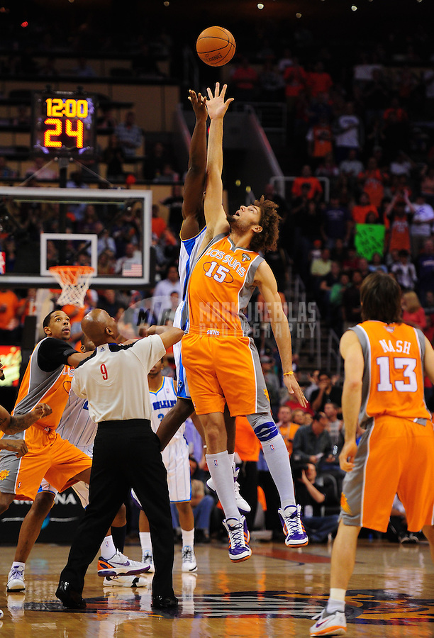 Mar. 25, 2011; Phoenix, AZ, USA; Phoenix Suns center (15) Robin Lopez jumps for the ball at the opening tipoff against the New Orleans Hornets at the US Airways Center. The Hornets defeated the Suns 106-100. Mandatory Credit: Mark J. Rebilas-.
