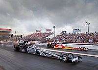 Apr 27, 2014; Baytown, TX, USA; NHRA top fuel dragster driver Shawn Langdon (near) races alongside Doug Kalitta during the Spring Nationals at Royal Purple Raceway. Mandatory Credit: Mark J. Rebilas-USA TODAY Sports