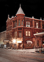 Old Crawford County Bank building inVan Buren Arkansas on the Historic Main Street taken at night during a snow storm.