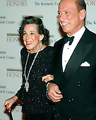 Washington, D.C. - December 2, 2006 -- Kitty Carlisle Hart and Lee Elman arrive for the State Department Dinner for the 29th Kennedy Center Honors dinner at the Department of State in Washington, D.C. on Saturday evening, December 2, 2006.  Andrew Lloyd Webber, Zubin Mehta, Dolly Parton, Smokey Robinson and Stephen Spielberg are being honored in 2006 for their contribution to American culture..Credit: Ron Sachs / CNP