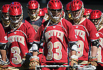 March 24, 2012:  Denver attackman, Alex Demopoulos (33), leads the Pioneers onto the field prior to ECAC lacrosse action between the #8 University of Denver Pioneers and the Air Force Academy Falcons at Falcon Stadium, U.S. Air Force Academy, Colorado Springs, CO.  Denver defeats Air Force 11-8.