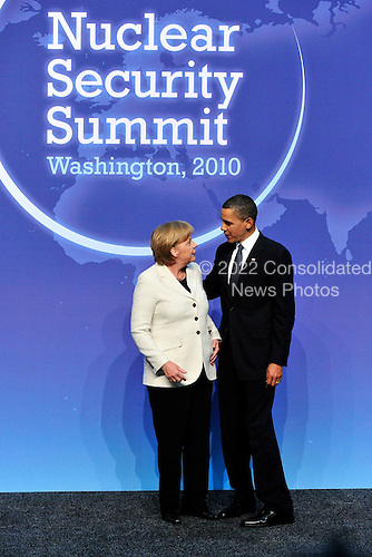 United States President Barack Obama welcomes Chancellor Angela Merkel of Germany to  the Nuclear Security Summit at the Washington Convention Center, Monday, April 12, 2010 in Washington, DC. .Credit: Ron Sachs / Pool via CNP