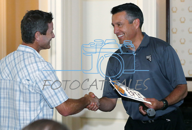 Gov. Brian Sandoval helps Todd Sadow kick off the Epic Rides Carson City Off-Road during a ceremony at the Governor's Mansion in Carson City, Nev., on Friday, June 17, 2016.<br />Photo by Cathleen Allison