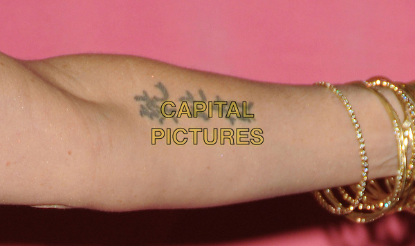 POPPY MONTGOMERY's arm.at The Women in Film 2009 Crystal .and Lucy Awards held at The Hyatt Regency Century Plaza in Century City, California, USA, June 12th 2009                                                                     .detail arm tattoo gold bracelets .CAP/DVS.©Debbie VanStory/RockinExposures/Capital Pictures