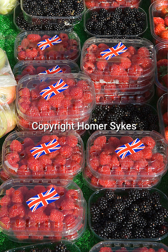 British Raseberrys with Union Jack sticker displayed on market stall. Blackheath Farmers Market. South East London. UK 2008.