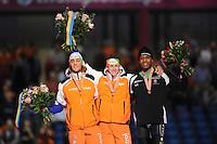 SCHAATSEN: HEERENVEEN: Thialf, Essent ISU World Single Distances Championships 2012, 23-03-2012, Podium 1000m Men, Kjeld Nuis (NED), Stefan Groothuis (NED), Shani Davis (USA), ©foto Martin de Jong