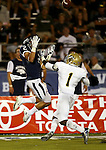 Nevada's Richy Turner goes up for a catch against UC Davis defender Dre Allen during the second half of a college football game in Reno, Nev., on Saturday, Sept. 7, 2013. (AP Photo/Cathleen Allison)