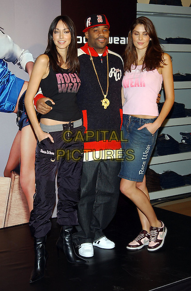 DAMON DASH with models CHANTAL & NIFA.CEO of ROC-A-WEAR clothing photocall at Selfridges, Oxford Street, London.10 December 2003.sales@capitalpictures.com.www.capitalpictures.com.©Capital Pictures