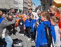 The Netherlands, Den Bosch, 16.04.2014. Fed Cup Netherlands-Japan, Street tennis on the market in the city center, captain Paul Haarhuis posing with kids<br /> Photo:Tennisimages/Henk Koster