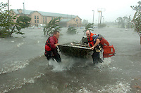 Jackson, Pascagoula, MS. 8/28/2005--HURRICANE KATRINA-- Fire rescue launch a boat to rescue a family in front of a Comfort Inn hotel flooded just off I10 in Pascagoula Miss. as Hurricane Katrina batters the area. PHOTOS 1 OF IMAGES STAFF MICHAEL SPOONEYBARGER
