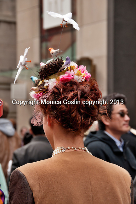 A woman wears a hat that looks like a bird's nest to the Easter Parade in New York City on Fifth Avenue