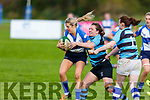Tralee's Irene Dillane still advancing after breaking loose of  the tackle from Shannon's Karen Harney in the Ladies Munster league in O'Dowd Park on Sunday.