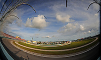 Nov. 22, 2009; Homestead, FL, USA; NASCAR Sprint Cup Series fans fill the grandstands as US Air Force F-16 fighter jets perform a fly over prior to the Ford 400 at Homestead Miami Speedway. Mandatory Credit: Mark J. Rebilas-