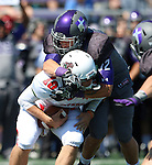 SIOUX FALLS, SD - SEPTEMBER 6: Cameron Ostrom #32 from the University of Sioux Falls brings down quarterback Lucas Romanski #18 from Minot State for a loss in the second quarter of their game Saturday afternoon at Bob Young Field in Sioux Falls.  (Photo by Dave Eggen/Inertia)