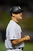 Birmingham Barons manager Omar Vizquel (13) during a Southern League game against the Chattanooga Lookouts on May 1, 2019 at Regions Field in Birmingham, Alabama.  Chattanooga defeated Birmingham 5-0.  (Mike Janes/Four Seam Images)