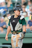 Catcher Eric Sim (11) of the Augusta GreenJackets in a game against the Greenville Drive on Friday, July 11, 2014, at Fluor Field at the West End in Greenville, South Carolina. Greenville won, 7-6. (Tom Priddy/Four Seam Images)
