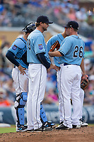 Durham Bulls pitching coach Kyle Snyder (39) has a meeting on the mound with relief pitcher Kyle Winkler (26) and catcher Curt Casali (9) during the game against the Buffalo Bisons at Durham Bulls Athletic Park on April 30, 2017 in Durham, North Carolina.  The Bisons defeated the Bulls 6-1.  (Brian Westerholt/Four Seam Images)