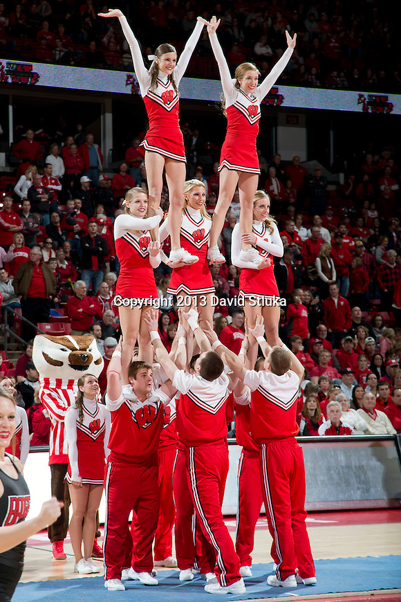 Wisconsin Badgers cheerleaders perform during a Big Ten Conference NCAA college basketball game against the Purdue Boilermakers Sunday, March 3, 2013, in Madison, Wis. Purdue won 69-56. (Photo by David Stluka)