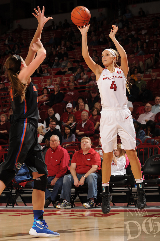NWA Democrat-Gazette/ANDY SHUPE<br />Keiryn Swenson (4) of Arkansas takes a shot over Haley Lorenzen of Florida Thursday, Jan. 28, 2016, during the first half of play in Bud Walton Arena. Visit nwadg.com/photos to see more photographs from the game.