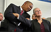 United States Secretary of Transportation Anthony Foxx (L) chats with Environmental Protection Agency Administrator Gina McCarthy as they attend an event where US President Barack Obama made remarks on the economy at a Safeway Distribution Center, February 18, 2014, in Upper Marlboro, Maryland. Obama pushed his economic plan by calling attention to the better fuel efficiency of tractor trailers, which improves the environment and saves money for industry.   <br /> Credit: Mike Theiler / Pool via CNP
