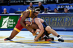 BROOKINGS, SD - NOVEMBER 4:  David Kocer from South Dakota State controls the leg of Leland Weatherspoon from Iowa State in their 174 pound match Friday evening at Frost Arena in Brookings. (Photo by Dave Eggen/Inertia)
