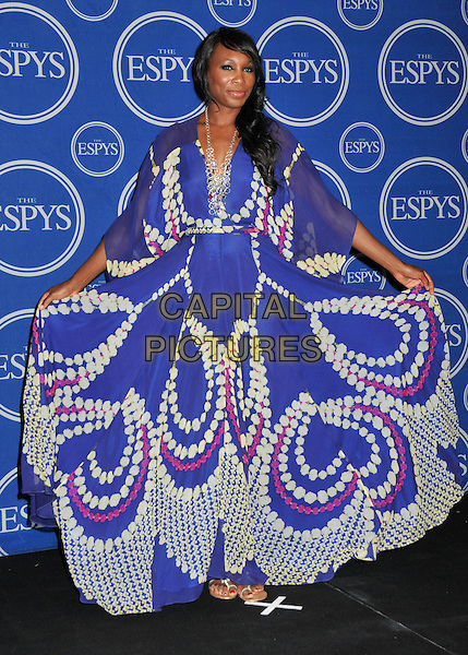 VENUS WILLIAMS .17th Annual ESPY Awards - Press Room held at Nokia Theatre LA Live, Los Angeles, CA, USA, 15th July 2009..full length long maxi blue print dress holding skirt long sleeves white floaty necklace espys .CAP/ADM/BP.©Byron Purvis/Admedia/Capital Pictures