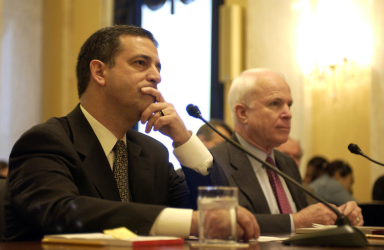 Russell Feingold, D-Wis., and John McCain, R-Ariz. talk before the start of the Senate Rules and Administration CommitteePolitical Organization Tax Loopholes.Full committee hearing to examine the scope and operation of organizations registered under Section 527 of the Internal Revenue Code..