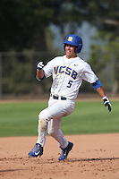 Luke Swenson (5) of the UC Santa Barbara Gauchos runs the bases during a game against the Kentucky Wildcats at Caesar Uyesaka Stadium on March 20, 2015 in Santa Barbara, California. UC Santa Barbara defeated Kentucky, 10-3. (Larry Goren/Four Seam Images)