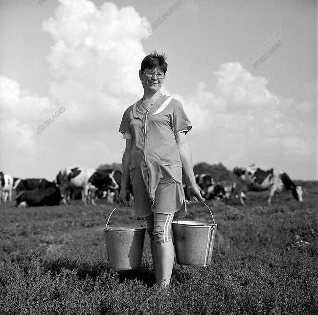 Lyobov Yukovits, senior milkmaid on the farm of the Resurrection near Mikhailov, Ryazan region. Russia, July 24, 2008.