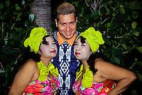 Mexican american man with two middle aged sexy Latina sisters with reed lipstick and yellow dress
