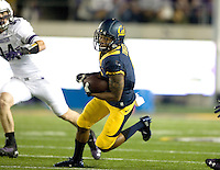 Bryce Treggs of California runs the ball after caught a pass from Goff during the game against Northwestern at Memorial Stadium in Berkeley, California on August 31st, 2013.  Northwestern defeated CAL, 44-30.