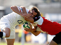 Photo: Richard Lane/Richard Lane Photography. .IRB Junior World Championship. England U20 v Canada U20. 10/06/2008. England's Charlie Sharples is tackled by Canada's Harry Jones.