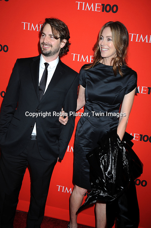 Kathryn Bigelow and guest posing for photographers at the Time Celebrates the Time100 Issue Gala on May 4, 2010 at The Time Warner Center in New York City. The magazine celebrates the 100 Most Influential People in the World.