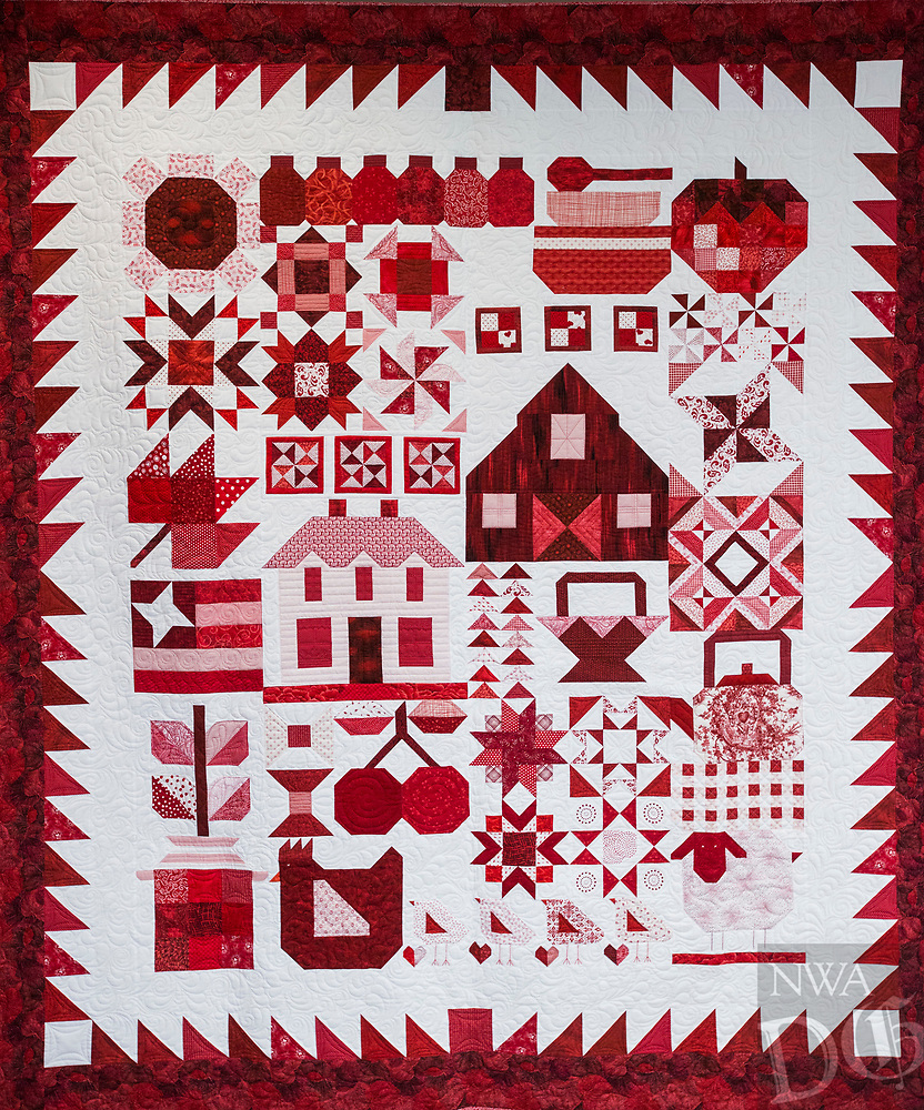 NWA Democrat-Gazette/ANTHONY REYES @NWATONYR<br /> &quot;Farm Girl Goes Red and White&quot; by Barbara Hamernik winner of Judge's Choice and First Place, Pieced, Twin/Full Size Category in the Tomorrow's Heirlooms XVI quilt show. Winning quilts Monday, April 3, 2017 at the Shiloh Museum in Springdale.