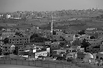 Seen from the water tower in Matan, a mosque minaret stands above Hableh. The Palestinian city of Qalqiliya is seen in background.