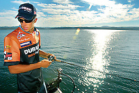 Roseville's Michael Bennett, a member of the FLW professional bass fishing tour, prepares for his third championship tournament on Folsom Lake in Granite Bay, Wednesday, July 18, 2007. (Pico van Houtryve/The Press-Tribune)