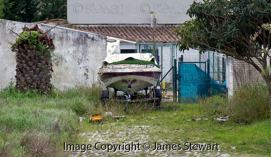 An old speedboat at the side of the former home of former Celtic player Jorge Cadete, who lost his fortune earned as a footballer, that was repossessed by the bank.