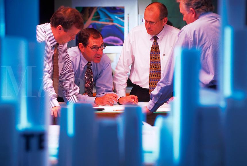 Petroleum engineers looking at seismic maps