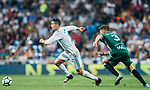 Cristiano Ronaldo (l) of Real Madrid is tackled by Francisco Javier Garcia Fernandez, Javi Garcia, of Real Betis during the La Liga 2017-18 match between Real Madrid and Real Betis at Estadio Santiago Bernabeu on 20 September 2017 in Madrid, Spain. Photo by Diego Gonzalez / Power Sport Images