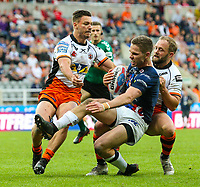 Leeds Rhinos' Matt Parcell is stopped short of the line by Castleford Tigers' Jv Hitchcox and Paul McShane<br /> <br /> Photographer Alex Dodd/CameraSport<br /> <br /> Betfred Super League Round 15 - Magic Weekend - Castleford Tigers v Leeds Rhinos - Saturday 19th May 2018 - St James' Park - Newcastle<br /> <br /> World Copyright &copy; 2018 CameraSport. All rights reserved. 43 Linden Ave. Countesthorpe. Leicester. England. LE8 5PG - Tel: +44 (0) 116 277 4147 - admin@camerasport.com - www.camerasport.com