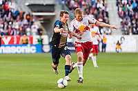 Antoine Hoppenot (29) of the Philadelphia Union is marked by Markus Holgersson (5) of the New York Red Bulls. The New York Red Bulls defeated the Philadelphia Union 2-1 during a Major League Soccer (MLS) match at Red Bull Arena in Harrison, NJ, on March 30, 2013.