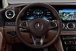 Car pictures of steering wheel view of a 2017 Mercedes Benz E-Class All-Terrain 5 Door Wagon Steering Wheel