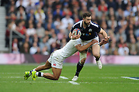 Alex Dunbar of Scotland is tackled by Jonathan Joseph of England during the RBS 6 Nations match between England and Scotland at Twickenham Stadium on Saturday 11th March 2017 (Photo by Rob Munro/Stewart Communications)