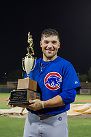Cam Balego (82) of the AZL Cubs holds the Chuck Jared Championship Cup after winning Game Three of the Arizona League Championship Series against the AZL Giants on September 7, 2017 at Scottsdale Stadium in Scottsdale, Arizona. AZL Cubs defeated the AZL Giants 13-3 to win the series two games to one. (Zachary Lucy/Four Seam Images)