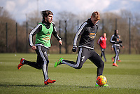 Pictured: Jay Fulton (R) against Alberto Paloschi Thursday 25 February<br />Re: Swansea City FC training at Fairwood, near Swansea, Wales, UK, ahead of their game against Tottenham Hotspur.