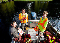 Interfor forest engineers safely aboard the crew boat after a close encounter with a grizzly bear. Left to right: Josh Waterhouse (Contract Engineer), Alan Hanuse (Logging Engineer), and Chris Bolton (Assistant Engineer). Hardy Inlet, Rivers Inlet, August 2012.