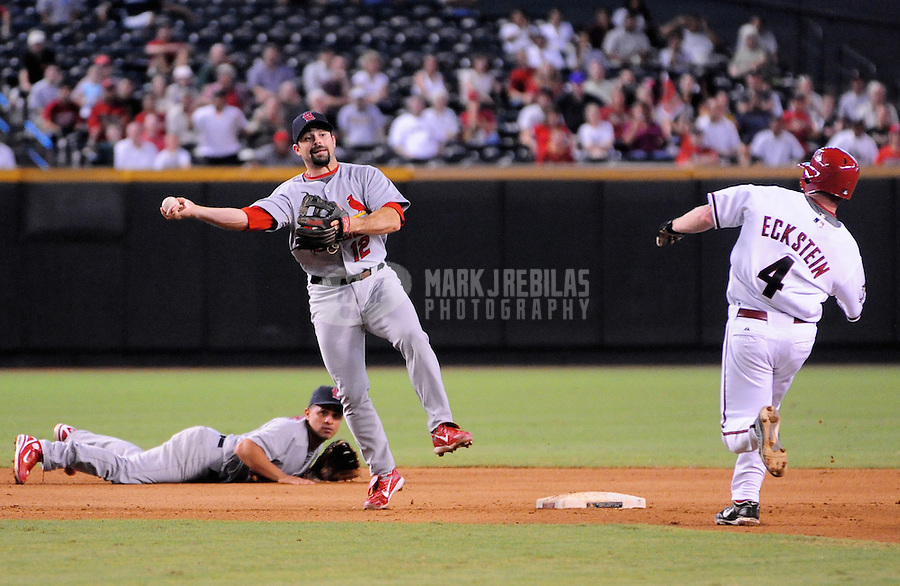 Sept 3, 2008; Phoenix, AZ, USA; St. Louis Cardinals infielder (12) Aaron Miles throws to first base after forcing out Arizona Diamondbacks base runner (4) David Eckstein at Chase Field. Mandatory Credit: Mark J. Rebilas-